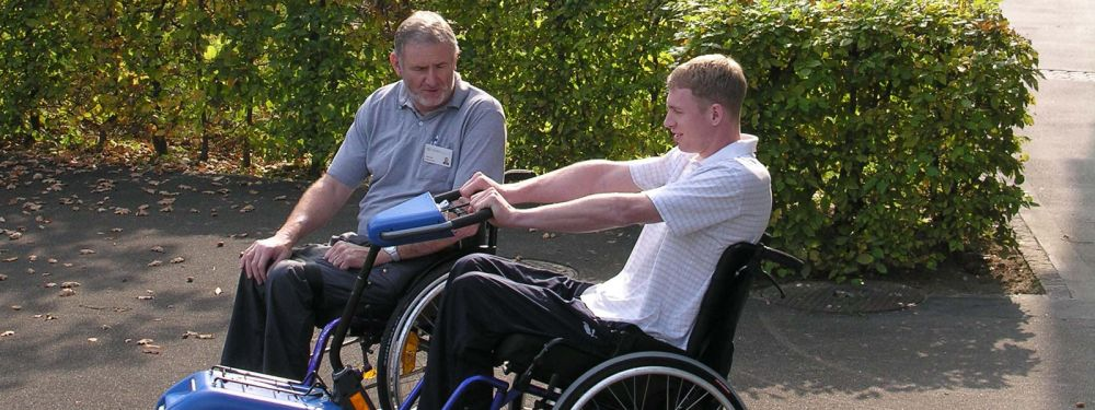 The Occupational Therapist Providing Wheelchair Training Outdoors